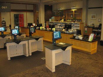 Image of the Circulation desk and self checkout stations