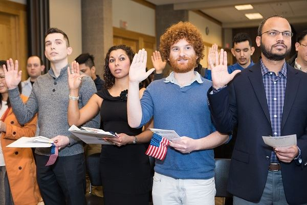 People taking the oath at the 2017 Naturalization Ceremony