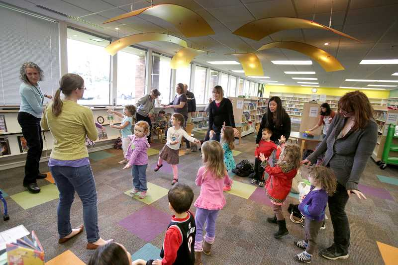 Image of storytime at Beaverton City Library Murray Scholls.
