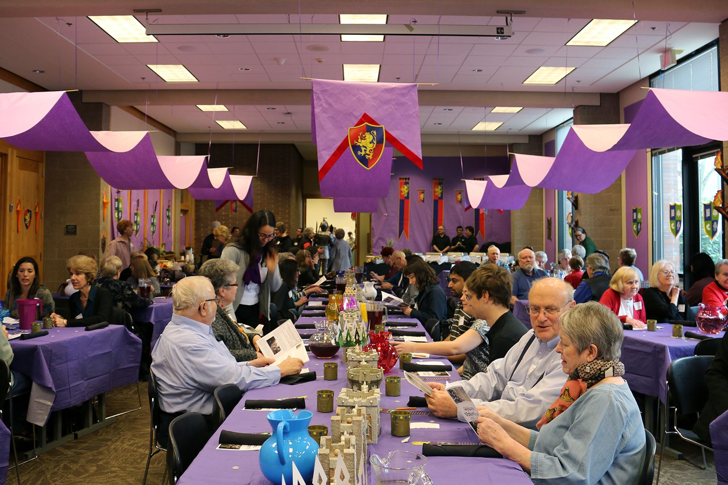 Photo of a meeting room colorfully decorated for a medieval-themed party.